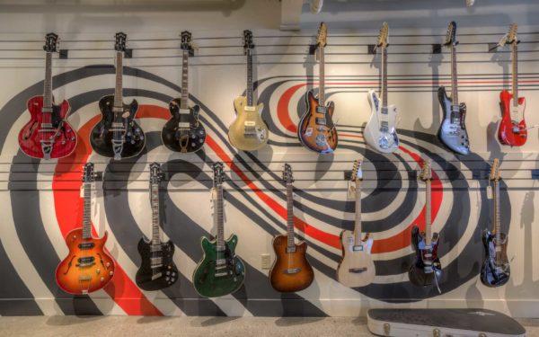 guitars hanging on the wall inside omaha ground floor guitars
